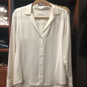 White silk v neck blouse.